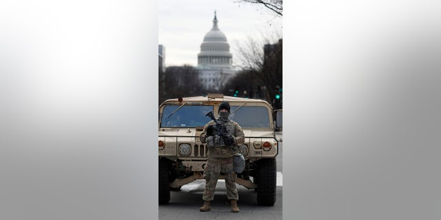 A National Guard stands on patrol outside the Capitol as security is heightened ahead of President-elect Joe Biden's inauguration ceremony Monday, Jan.. 18, 2021, in Washington.