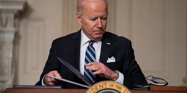 In this Jan. 27, 2021, file photo President Joe Biden signs a series of executive orders on climate change, in the State Dining Room of the White House in Washington. (AP Photo/Evan Vucci, File)