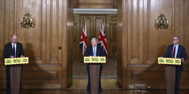 Britain's Prime Minister Boris Johnson, flanked by Chief Medical Officer for England Chris Whitty, left, and Chief Scientific Adviser Sir Patrick Vallance, speaks during a news conference about the coronavirus pandemic on Tuesday. (AP)