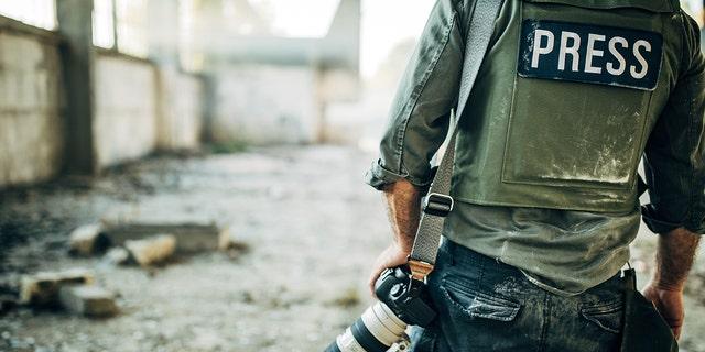 Journalist wears bulletproof vest. (iStock)