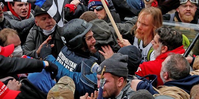 Pro-Trump protesters clash with police during a rally to contest the certification of the 2020 U.S. presidential election results by the U.S. Congress, at the U.S. Capitol Building in Washington, U.S, January 6, 2021. Picture taken January 6, 2021. REUTERS/Shannon Stapleton