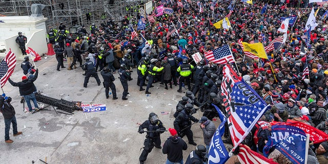 Rioters and police clash outside the U.S. Capitol in Washington, Jan. 6, 2021. (Getty Images)
