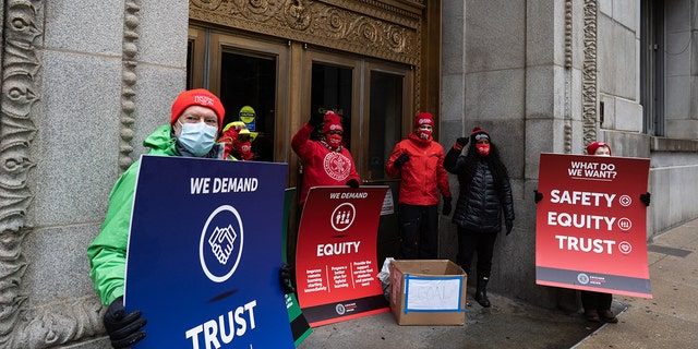 Chicago Teachers Union leadership list their demands and leave a box of coal outside the entrance of City Hall following a car caravan where teachers and supporters demanded a safe and equitable return to in-person learning during the COVID-19 pandemic in Chicago on Dec. 12, 2020. (Photo by Max Herman/NurPhoto via Getty Images)
