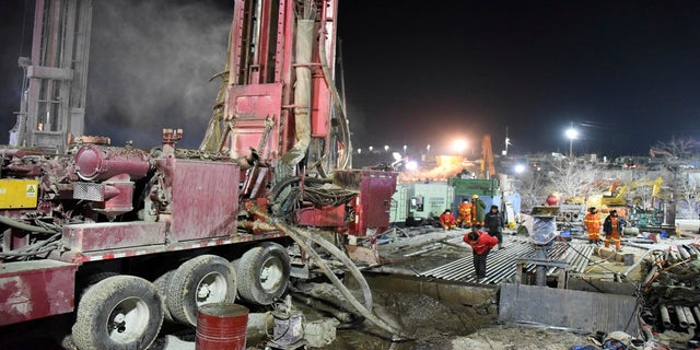 Rescuers drill a new channel at the site of a gold mine that exploded in Qixia City, China, on Monday. (AP/Xinhua)