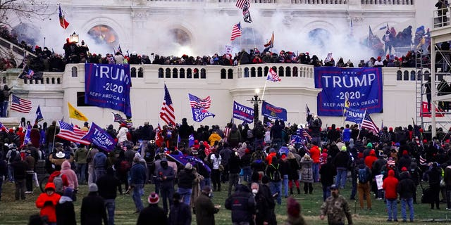 Violent rioters, loyal to former President Donald Trump, storm the Capitol in Washington.  (AP Photo / John Minchillo, File)