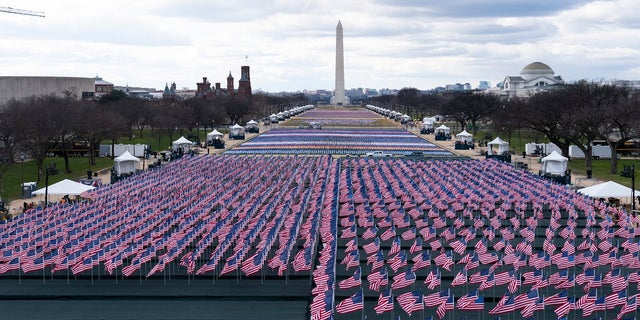 Flags are placed on the National Mall, looking towards the Washington Monument, and the Lincoln Memorial, ahead of the inauguration of President-elect Joe Biden and Vice President-elect Kamala Harris. (AP)