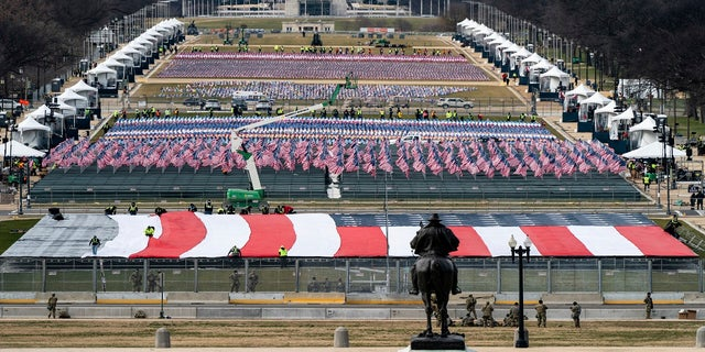 The National Mall is filled with a display of flags, as seen during a rehearsal for the 59th Presidential Inauguration at the U.S. Capitol in Washington, on Monday. (AP/The New York Times)