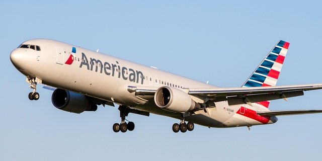 """""""Travel restrictions for international have resulted in reduced demand,"""" American Airlines CEO Doug Parker said."""
