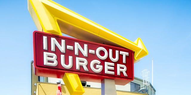 According to reports, a woman driving a silver BMW cut in front of two men who were already waiting in the drive-thru of an In-N-Out in Utah.