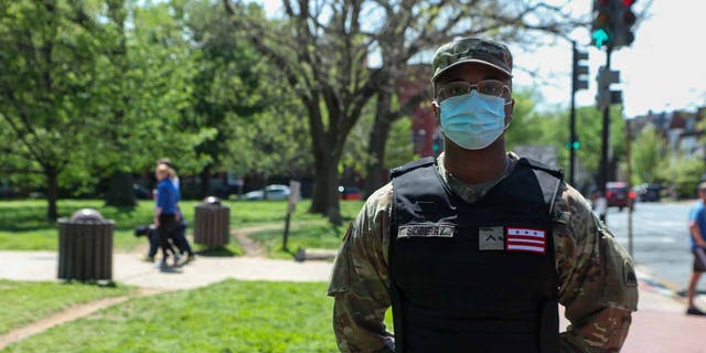 D.C. National Guardsman wears a black identification vest instead of a camouflage option.