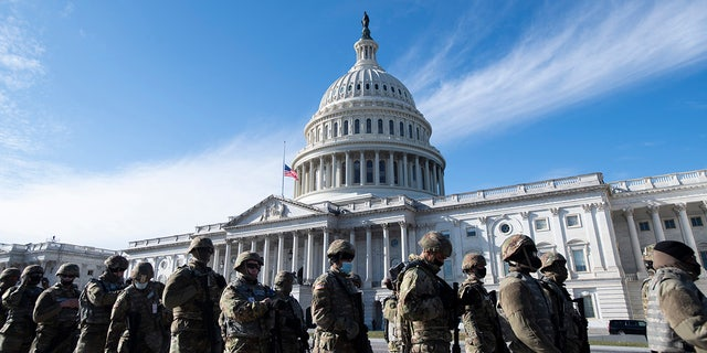 National Guard troops stand outside the U.S. Capitol before a dress rehearsal for the 59th inaugural ceremony for President-elect Joe Biden and Vice President-elect Kamala Harris at the Capitol, Monday, Jan. 18, 2021, in Washington.