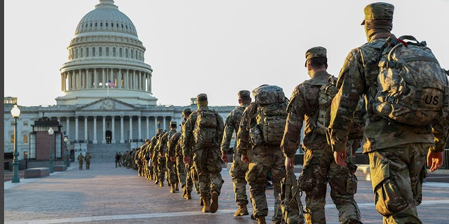 Members of the U.S. National Guard arrive at the U.S. Capitol on Jan. 12, 2021 in Washington, DC. The Pentagon is deploying as many as 15,000 National Guard troops to protect President-elect Joe Biden's inauguration on January 20, amid fears of new violence. (Tasos Katopodis/Getty Images)