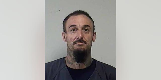 Joshua Ziminski, 35, of Racine, was charged with arson, disorderly conduct with a dangerous weapon and obstructing an officer. (Kenosha County Sheriff's Office)
