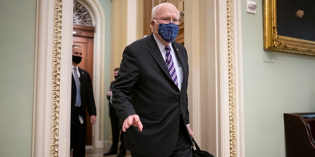 """Sen. Patrick Leahy, D-Vt., the president pro tempore of the Senate, arrives at the Capitol in Washington, Tuesday, Jan. 26, 2021. Leahy swore senators in to do """"impartial justice"""" during former President Donald Trump's second impechment trial. (AP Photo/J. Scott Applewhite)"""