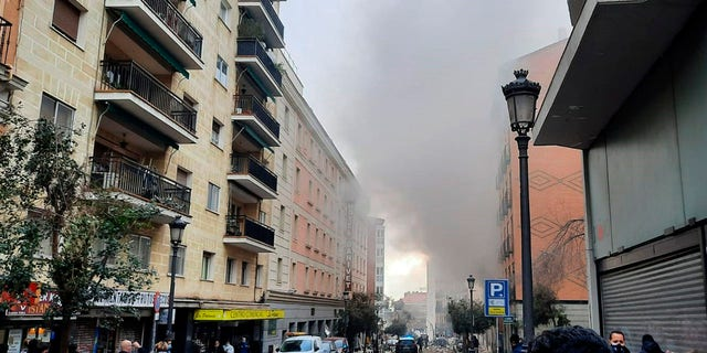 A loud explosion of unknown origin has partially destroyed a six-floor-tall building flanked by a school and a nursing home in the center of Spain's capital, Madrid. (Europa Press via AP)