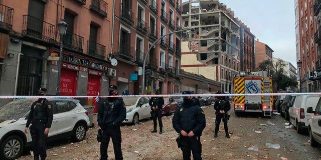 Police officers cordon off Toledo Street following an explosion in downtown Madrid, Spain, Wednesday, Jan. 20, 2021. (AP Photo/Bernat Armangue)