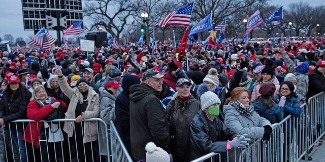 People wait for a rally of supporters of President Donald Trump challenging the results of the 2020 U.S. presidential election on the Ellipse outside of the White House on January 6, 2021, in Washington, DC. (Photo by Brendan Smialowski/AFP via Getty Images)