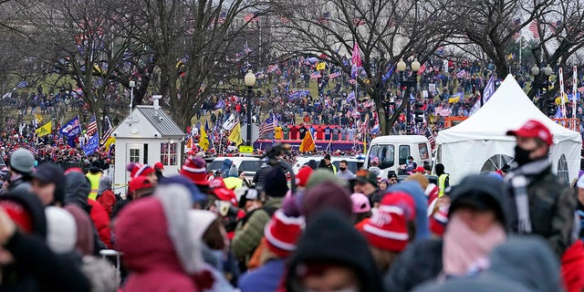 """People attend a rally in support of President Donald Trump called the """"Save America Rally,"""" Wednesday, Jan. 6, 2021, in Washington. (AP Photo/Jacquelyn Martin)"""