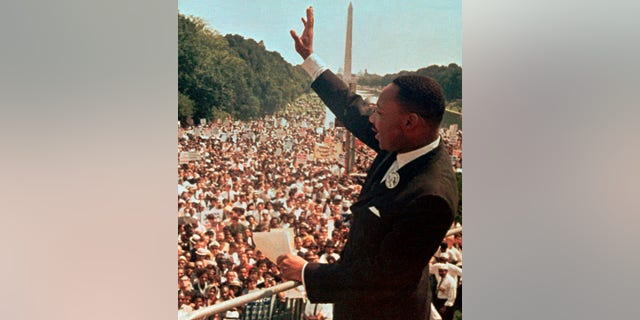 """Dr. Martin Luther King Jr. acknowledges the crowd at the Lincoln Memorial for his """"I Have a Dream"""" speech during the March on Washington, D.C. on Aug. 28, 1963. (AP Photo)"""