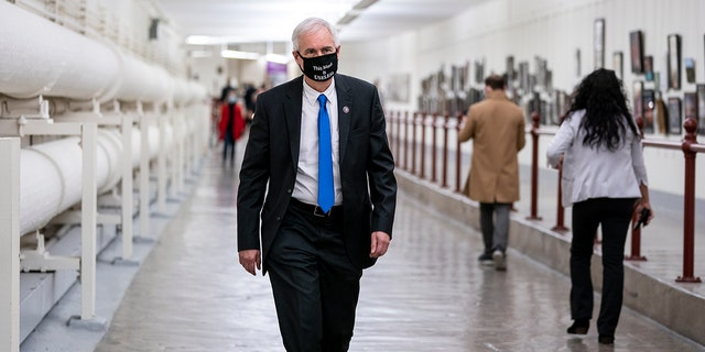 Rep. Tom McClintock (R-CA) wears a protective mask while walking through the Cannon Tunnel to the U.S. Capitol on January 12, 2021, in Washington, DC.  (Photo by Stefani Reynolds/Getty Images)