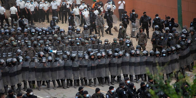 Guatemalan soldiers and police block Honduran migrants from advancing toward the US border, on the highway in Vado Hondo, Guatemala, Monday, Jan. 18, 2021. (AP Photo/Sandra Sebastian)