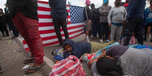 Honduran migrants rest as they are blocked by Guatemalan soldiers and police from advancing toward the US border, on the highway in Vado Hondo, Guatemala, Monday, Jan. 18, 2021. (AP Photo/Sandra Sebastian)