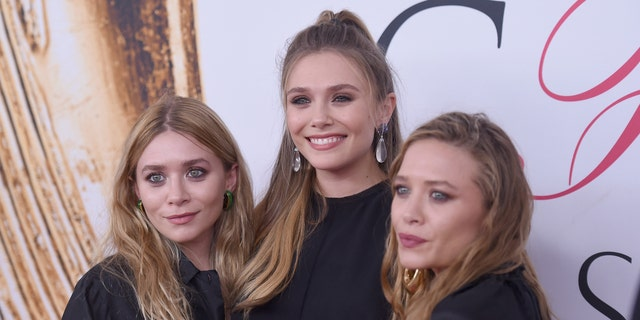 Elizabeth Olsen (center) and Mary-Kate (R) and Ashley Olsen (L).
