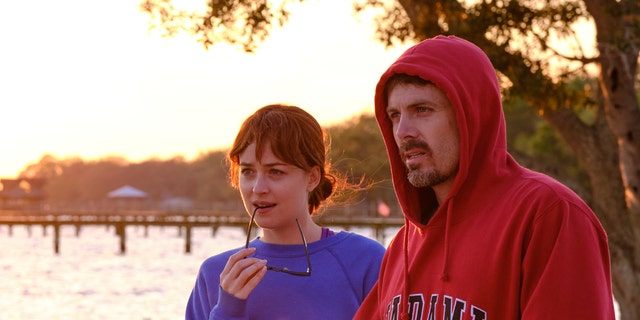 L-R: Dakota Johnson as Nicole Teague, Casey Affleck as Matt Teague in 'Our Friend.'