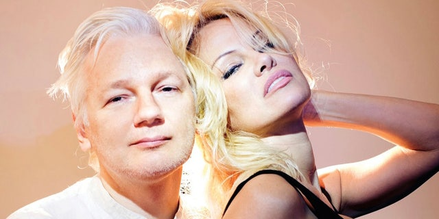 Actress Pamela Anderson and editor of WikiLeaks Julian Assange pose for a portrait on March 12, 2017 in London, England.