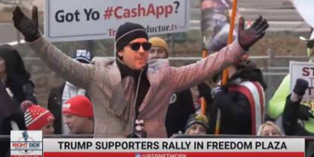 "The criminal complaint also included a screenshot of Straka's speech at the ""Stop the Steal"" rally in Freedom Plaza on Jan. 5. It noted he was wearing the same hat, sunglasses, and coat that he wore the next day in the video at the Capitol. (Dipartimento di Giustizia)"