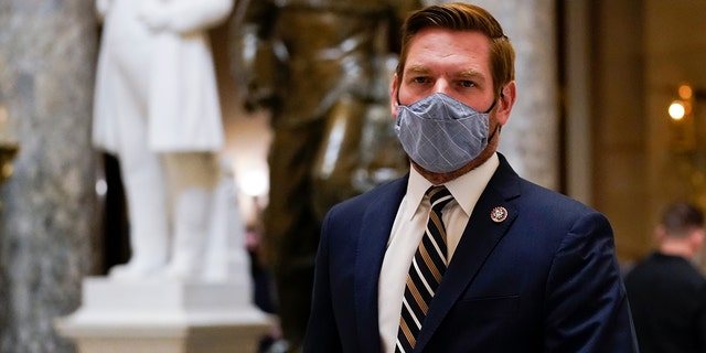 Impeachment manager Rep. Eric Swalwell, D-Calif., walks on Capitol Hill in Washington, Wednesday, Jan. 13, 2021. (AP Photo/Susan Walsh)