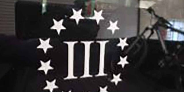 """Officers found a """"Three Percenter"""" sticker on Rogers' truck. (Justice Department)"""
