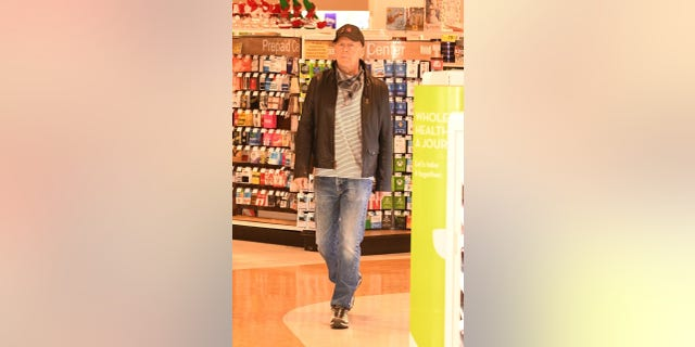 Bruce Willis was photographed at a Rite Aid in Los Angeles after refusing to put on a mask.