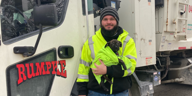 Aaron Kinsel was working Wednesday morning when he noticed a bag moving on the side of the road and went to investigate. A 10-week-old boxer-mix puppy was inside. (Rumpke)