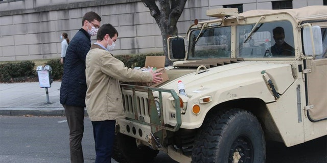 Sen. Pat Toomey's staff prepare to distribute candy care packages on Jan. 15, 2021, to National Guard members stationed in force at the Capitol.