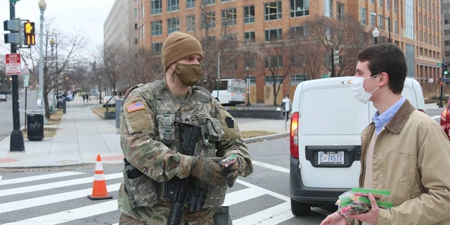 A staffer for Sen. Pat Toomey, R-Penn., delivers candy care packages to members of the National Guard on Friday.