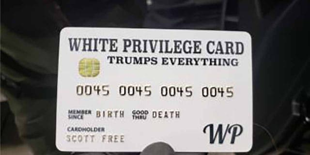 """Officers found a """"White Privilege Card"""" while executing search warrants on Rogers' home and business. (Justice Department)"""