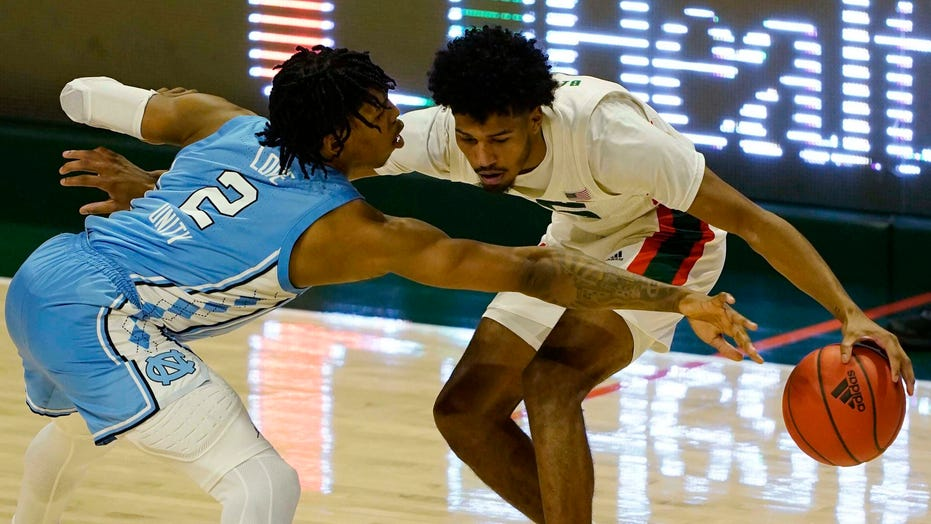 Platek's runner sends Tar Heels past Miami 67-65