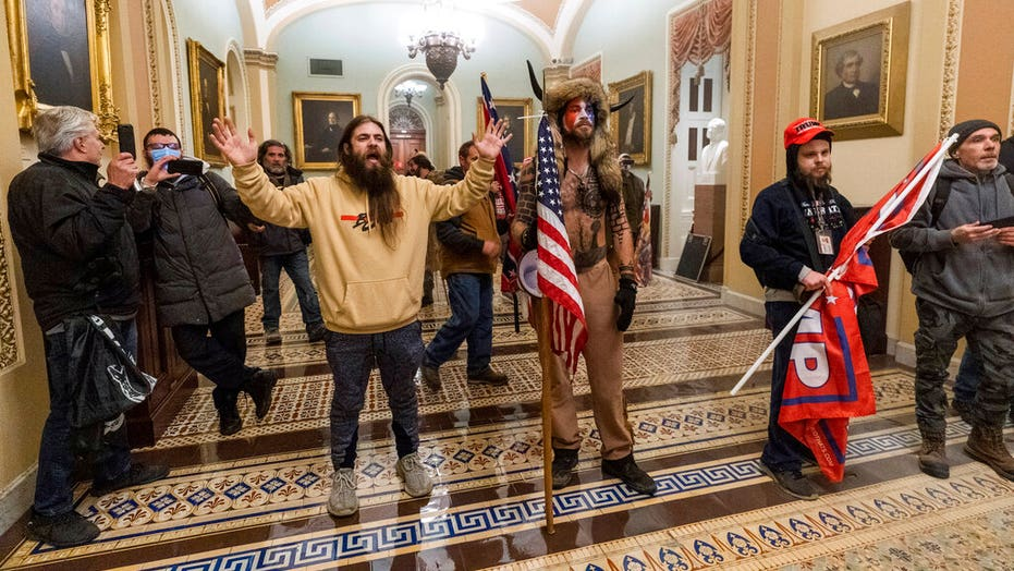 'QAnon Shaman' Capitol rioter wants pardon from Trump