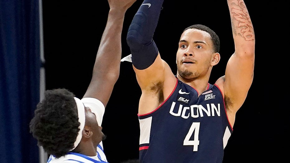 Unexpected win has UConn fans downing hot sauce for charity