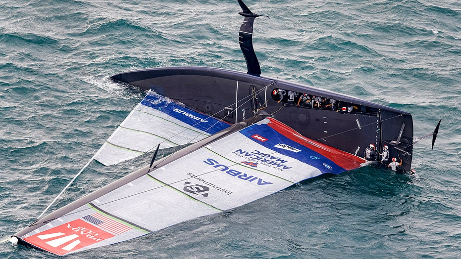 US yacht goes airborne, capsizes in lead-up race to America's Cup