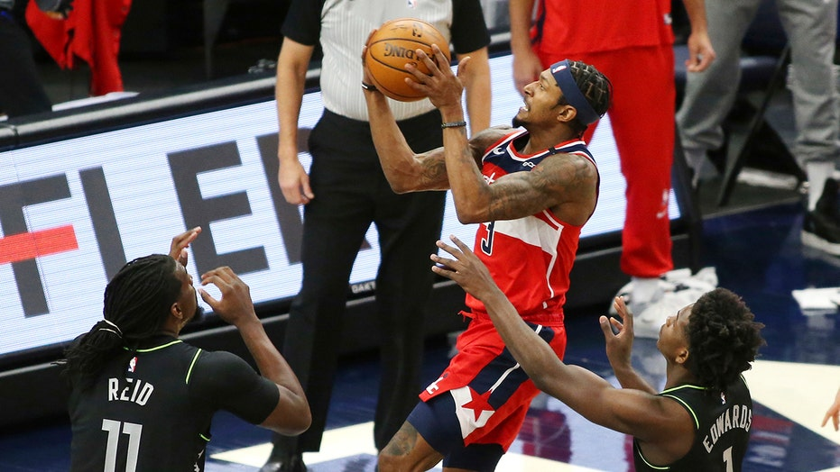 Beal leads Wizards, minus Westbrook, past Wolves for 1st win