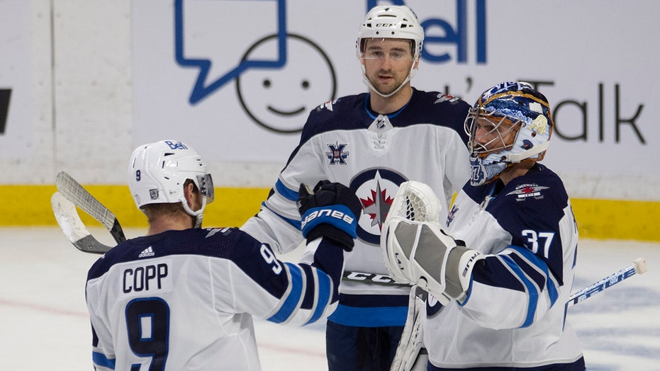 Connor Hellebuyck makes 28 saves, Jets beat Senators 4-1