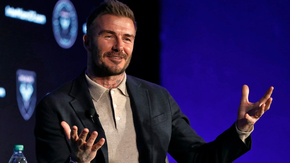 Beckham says Neville hired as coach on merit, not friendship