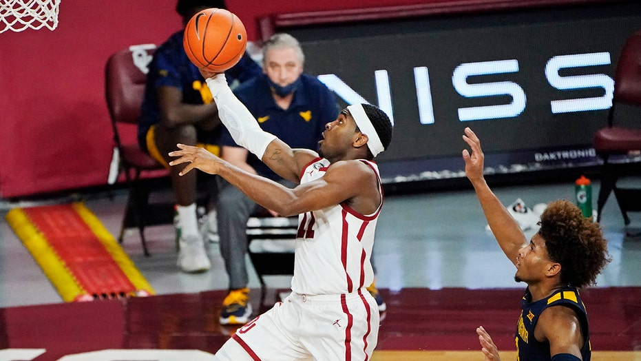 Gibson hits 8 3s, Oklahoma beats No. 9 West Virginia 75-71