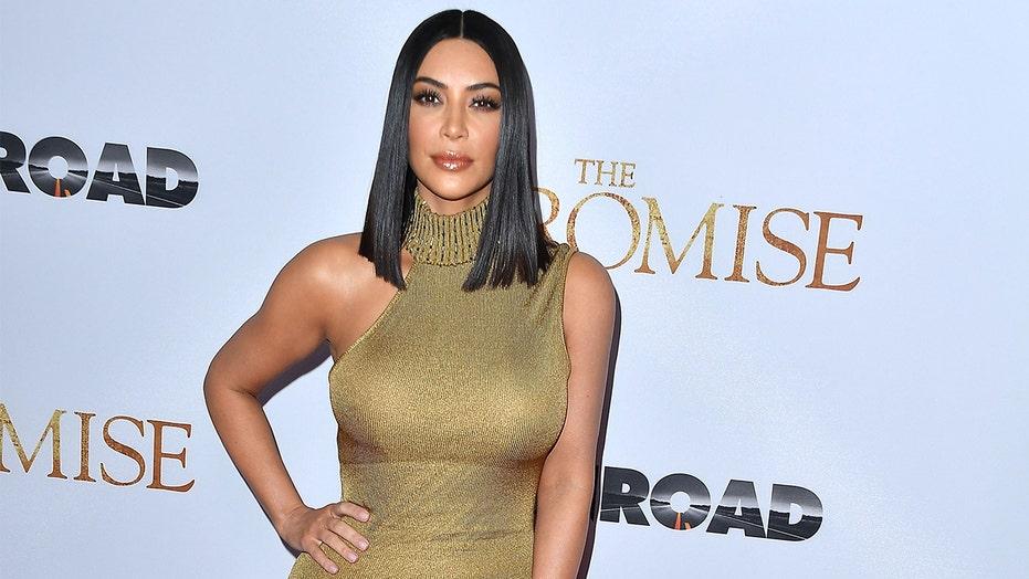 Kim Kardashian wishes fans 'a great day' with bikini snapshot