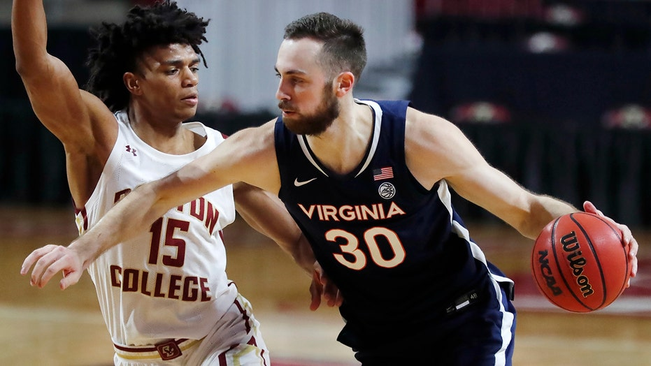 Huff leads No. 22 Virginia past Boston College 61-49