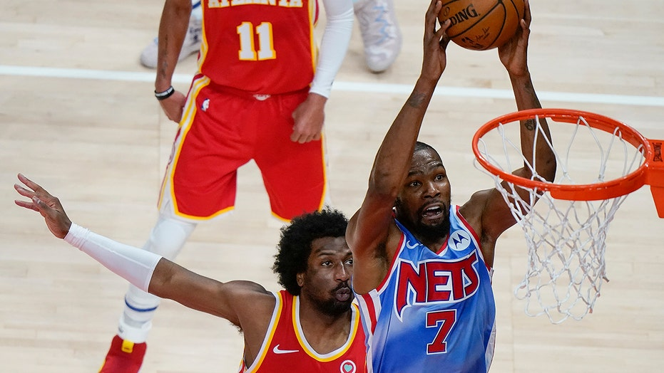 Durant's 32 points lead Nets past Young, Hawks 132-128 in OT
