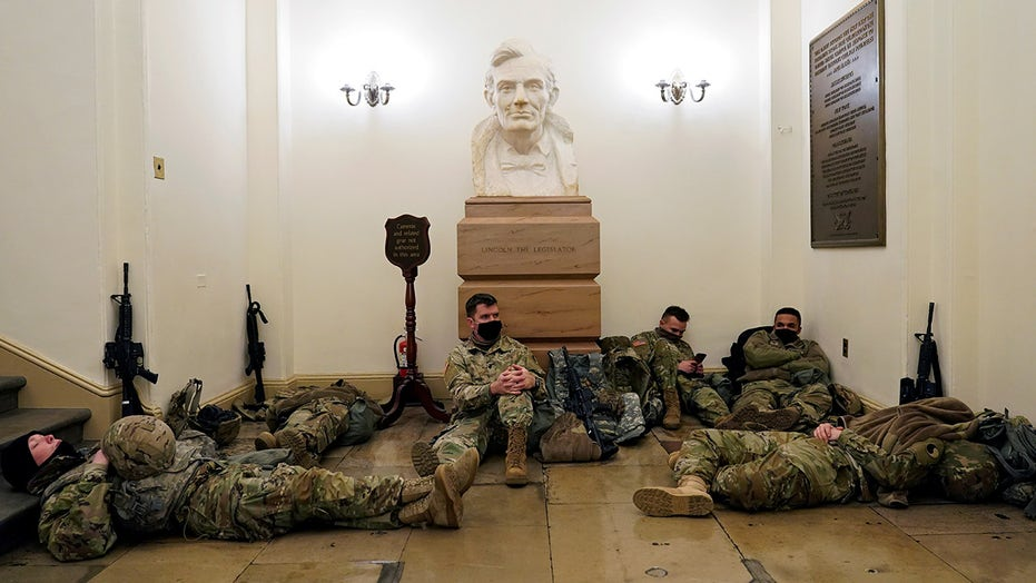 Troops seen napping inside Capitol building ahead of impeachment trial