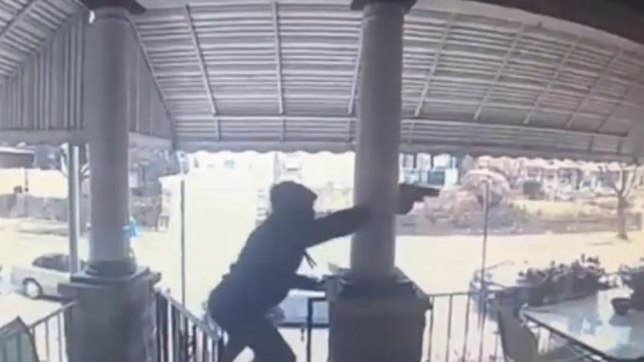 Philadelphia police searching for gunmen caught on video firing at least 20 shots at man on porch